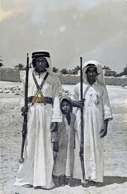 Two Saudi Men and Small Child