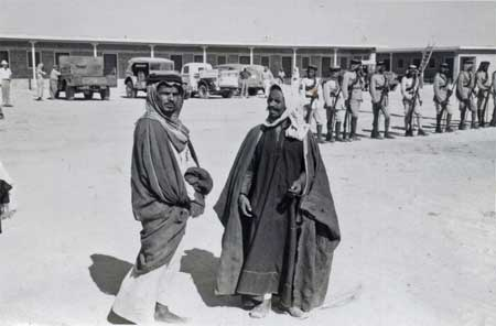 Two Saudi Men with Guards