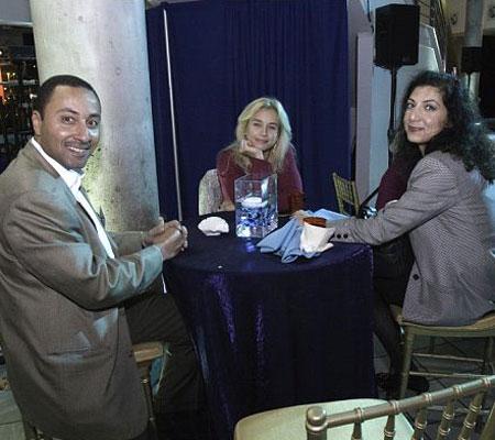 Deya Elyas sits with friends