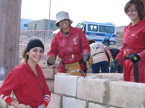 Women builders Sophia, Wiam & Nourah lay some blocks (left to right)