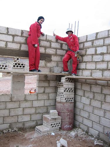 Latifia and Hiba finishing up a wall