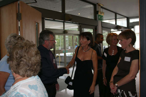 Tom greeting Jo Phillips, Karen Jennings & Linda Powell.