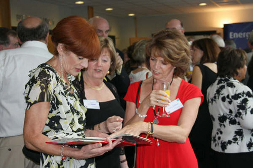 Tricia Ryan, Jean Sullivan & Lesley Williams looking at old photos