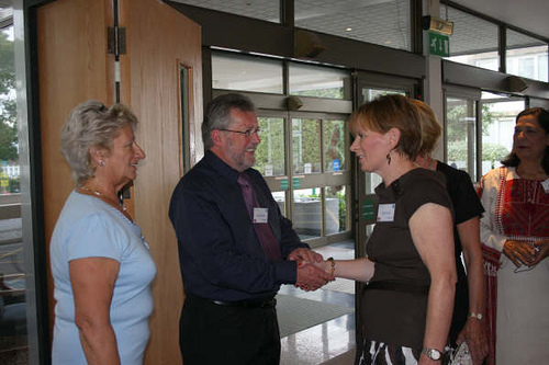 Tom & Eileen welcoming Linda Powell