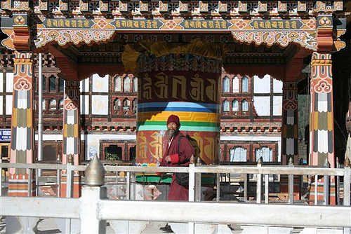 Prayer Wheel and Bhutanese Man