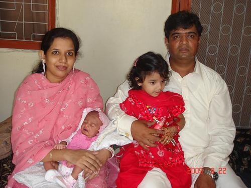 Erum, Imran, baby Zara, and Zoya