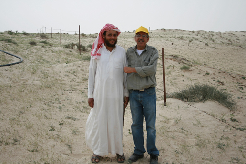 Faisal with camel herder of Ajmi tribe